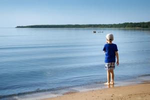 child entering the sea